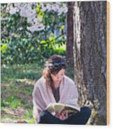 Reading Beneath The Cherry Blossoms Wood Print