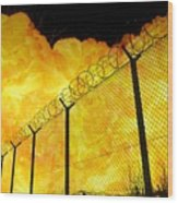 Realistic Fiery Explosion Behind Restricted Area Barbed Wire Fence Wood Print