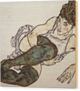 Reclining Woman With Green Stockings Wood Print