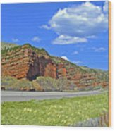 Red Cliffs And White Clouds Over Interstate 80 Rest Stop In Utah  Wood Print