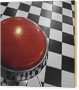 Red Cushion Stool Above Chequered Floor Wood Print by Peter Young