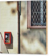 Red Fire Box With Window, Shadows And Gutter Wood Print