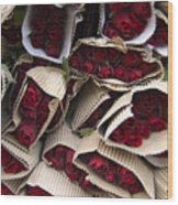 Red Roses Wrapped In Paper Displayed Wood Print