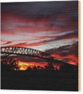 Red Skies At Pleasure Island Bridge Wood Print
