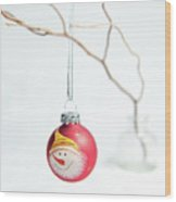 Red Snowman Bauble On A Branch Wood Print