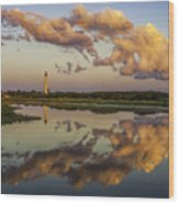 Reflection Of Clouds And Lighthouse Wood Print