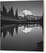 Reflection Of Mount Rainer In Calm Lake Wood Print by Bill Hinton Photography