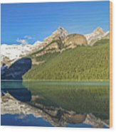 Reflections In The Water At Lake Louise, Canada Wood Print