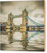 Reflections On Tower Bridge Wood Print