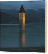 Reschensee By Night Wood Print by Yair Karelic