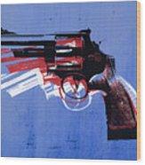 Revolver On Blue Wood Print by Michael Tompsett
