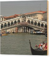 Rialto Bridge In Venice With Gondola Wood Print
