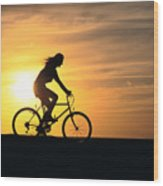 Riding At Sunset Wood Print