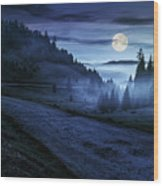 Road Near Foggy Forest In Mountains At Night Wood Print
