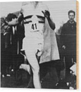 Roger Bannister Crossing The Finish Wood Print