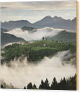 Rolling Fog At Sunrise With Mountains Of Kamnik Savinja Alps At  Wood Print