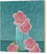 Roses In Clear Blue Jar Wood Print