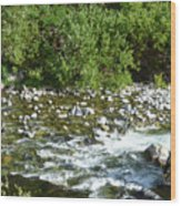 Rounded Rocks In A Rushing River Wood Print