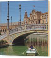 Row Boating In Seville Wood Print
