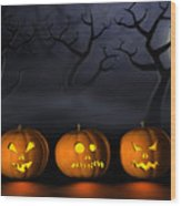 Row Of Halloween Pumpkins In A Spooky Forest At Night Wood Print