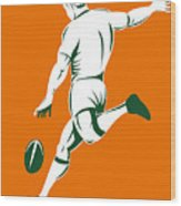 Rugby Player Kicking Wood Print