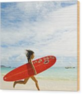 Running With Surfboard Wood Print