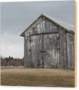Rustic Barn With Dark Clouds Wood Print
