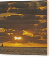 Sailboat As The Sun Sets Wood Print