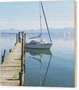 Sailing Boat And Reflection By Lake Pier Wood Print