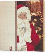 Santa Claus At Open Christmas Door Wood Print