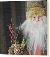 Santa Claus Doll In Green Suit With Forest Background. Wood Print