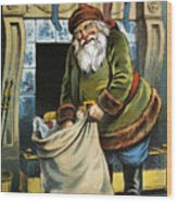 Santa Unpacks His Bag Of Toys On Christmas Eve Wood Print