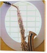 Saxophone In Round Window Wood Print