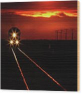 Scenic View Of An Approaching Trrain Near Sunset Wood Print