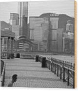 Seated Man Practicing Yoga With View Of Skyline In The Background Wood Print by Sami Sarkis