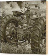 Sepia Toned Old Farmall Tractor In A Grassy Field Wood Print