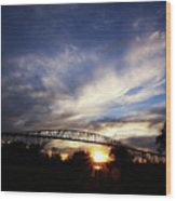 Setting Sun And Cloudy Skies Wood Print