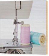 Sewing Threads In Pastel Colors And Detailed View Of A Sewing Machine Wood Print