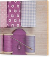 Sewing Threads Needle And Fabrics On A Wooden Box Wood Print
