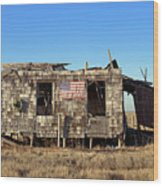 Shack With American Flag Wood Print by John Greim