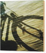 Shadow Of A Person Riding A Bicycle Wood Print