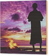 Silhouette Of A Local Man Standing By The Bonfire On The Beach In Maldives During Dramatic Sunset Wood Print