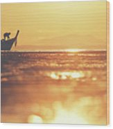 Silhouette Of A Thai Fisherman Wooden Boat Longtail During Beautiful Sunrise Wood Print