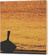 Silhouette Of A Thai Wooden Boat  On The Beach Against Golden Sunset Koh Lanta, Thailand Wood Print
