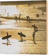 Silhouette Of Surfers At Sunset Wood Print