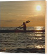 Silhouette Of Woman Kayaking In The Ocean. Wood Print