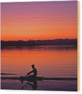 Silhouetted Man Rowing Wood Print