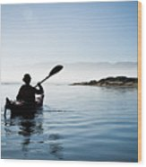 Silhouetted Morro Bay Kayaker Wood Print by Bill Brennan - Printscapes