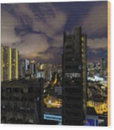 Singapore Cityscape On A Cloudy Night Wood Print
