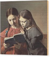 Sisters Reading A Book Wood Print by Carl Hansen